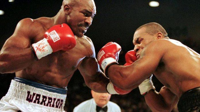 Evander Holyfield e Mike Tyson já se enfrentaram duas vezes Imagem: Gary Hershorn